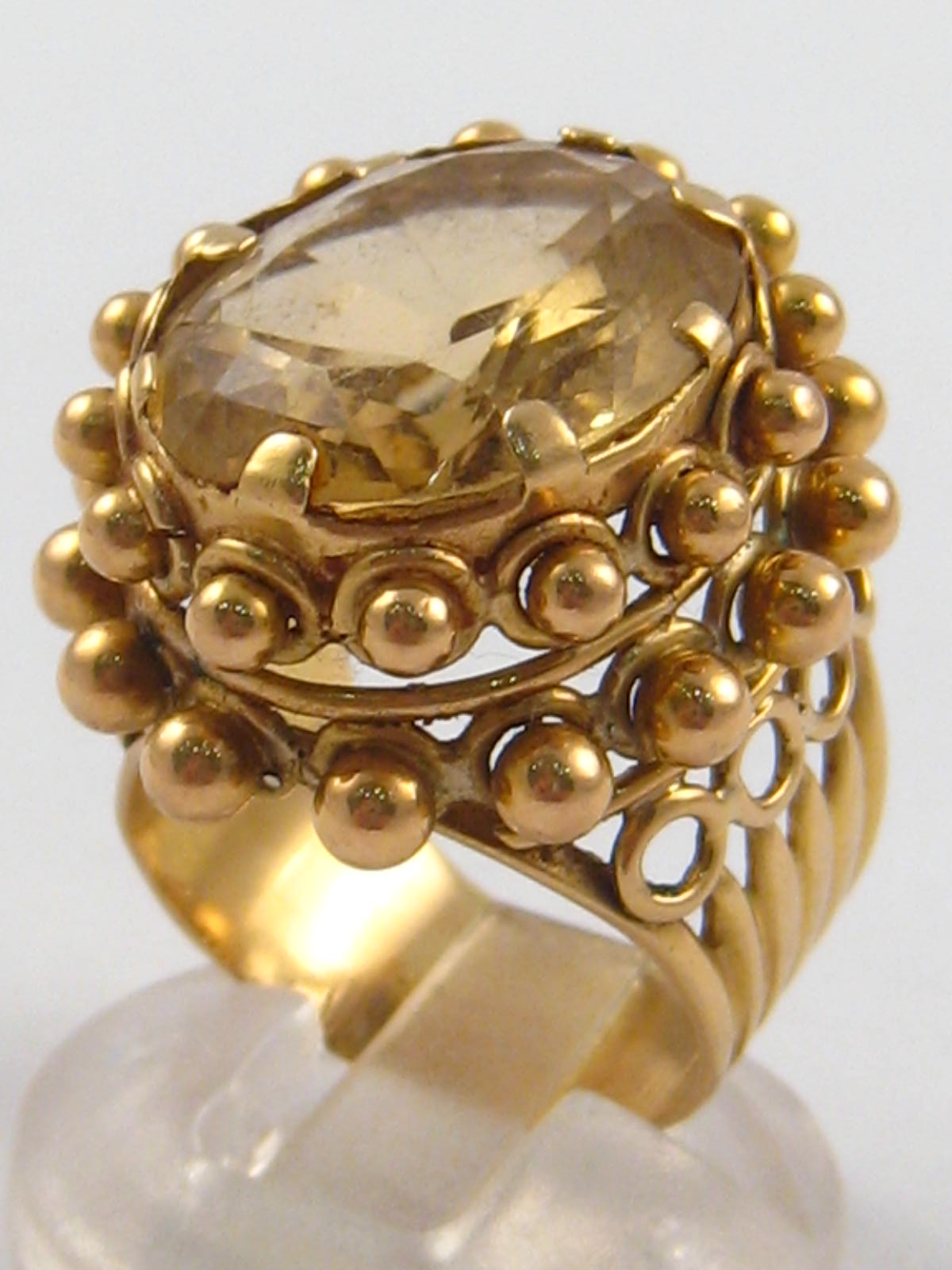 A yellow metal (tests 18 carat gold) citrine ring, citrine approx. 18 x 14mm, ring size M, 12.7 gms.