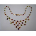 "A yellow metal (tests 14 carat gold) multi gem ""tutti frutti"" fringe necklace, approx 38cm long,"
