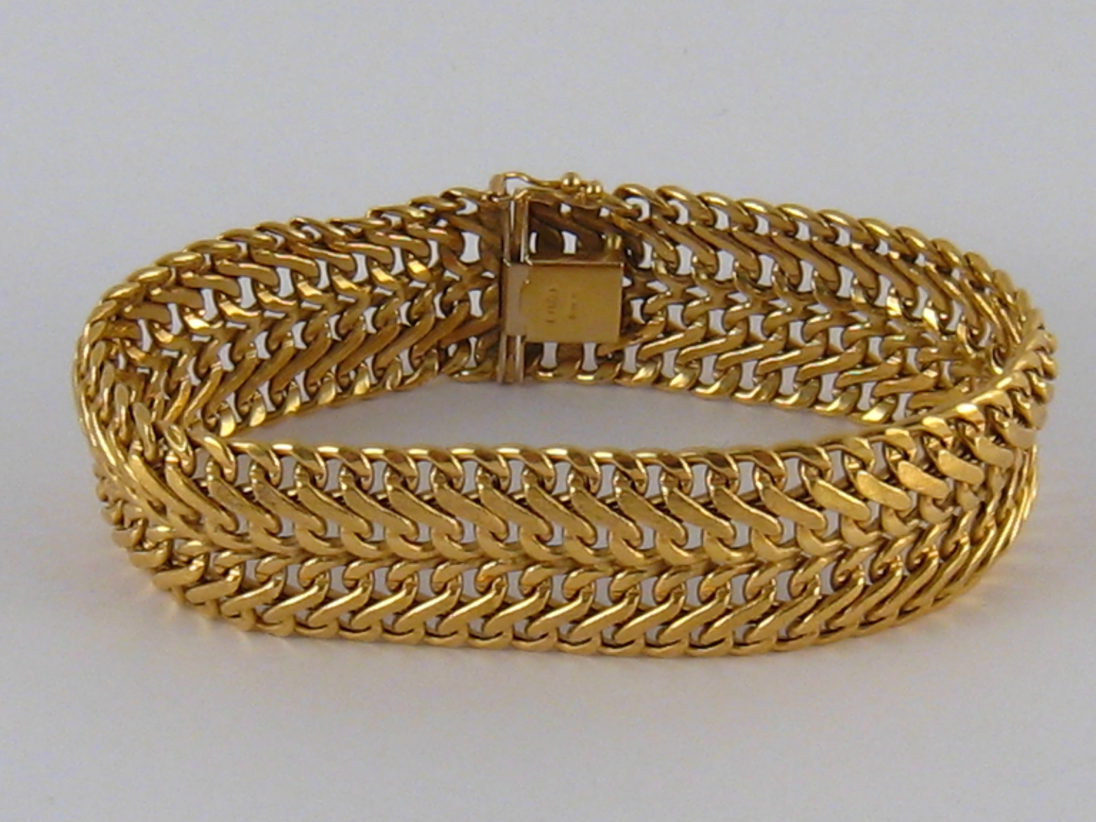 Lot 73 - A yellow metal (tests 18 carat gold) bracelet, approx 19.5cm long, 2cm wide, 23.