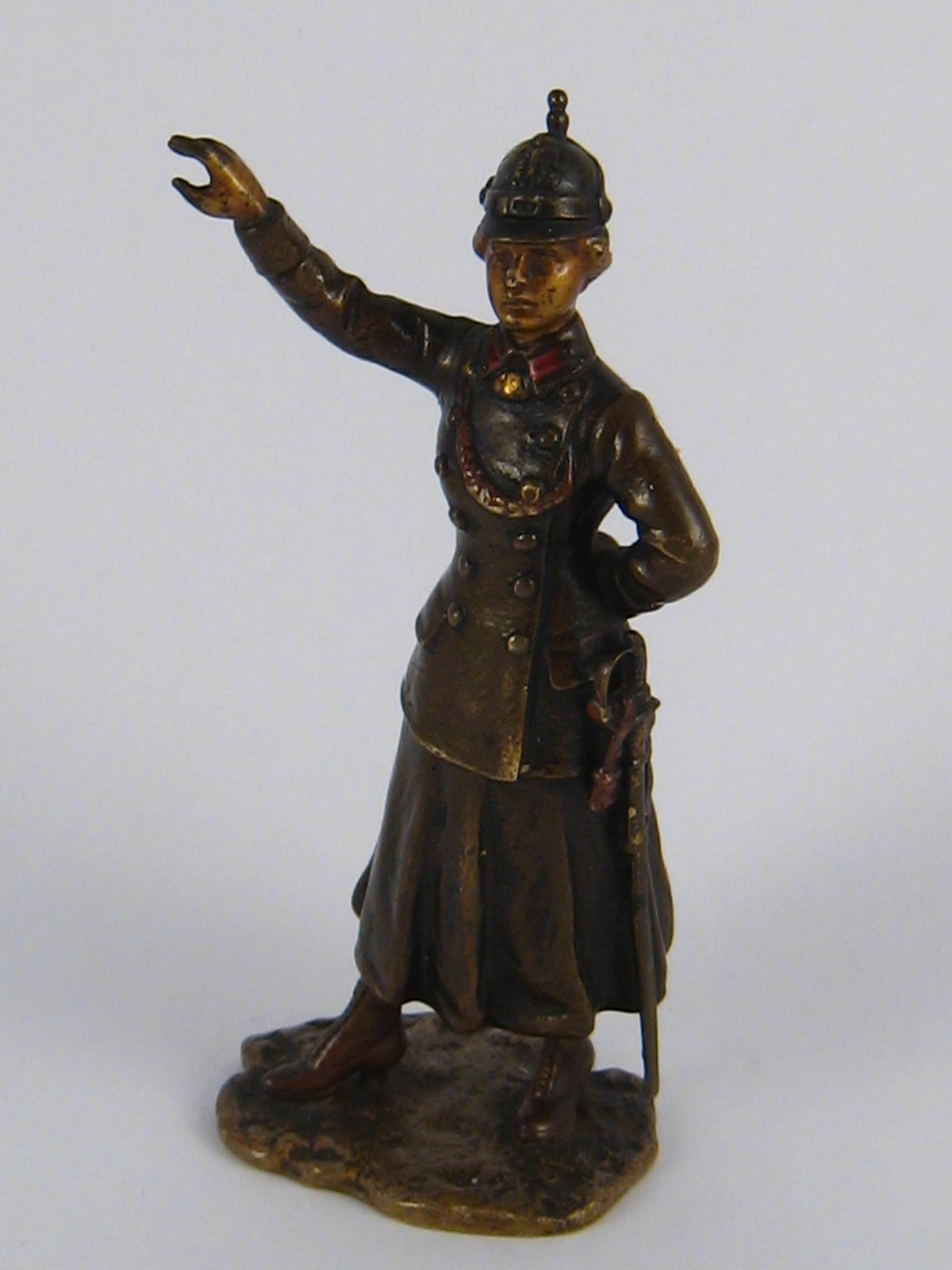 Lot 360 - A cold painted Austrian bronze figure of a woman officer wearing a pickelhalb helmet,