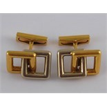 A pair of French hallmarked 18 carat yellow and white gold cufflinks by Fred Paris, signed Fred,