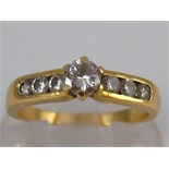 A yellow metal (tests 18 carat gold) diamond ring,