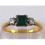 A yellow metal (tests 18 carat gold) emerald and diamond ring, emerald approx 4x4mm,