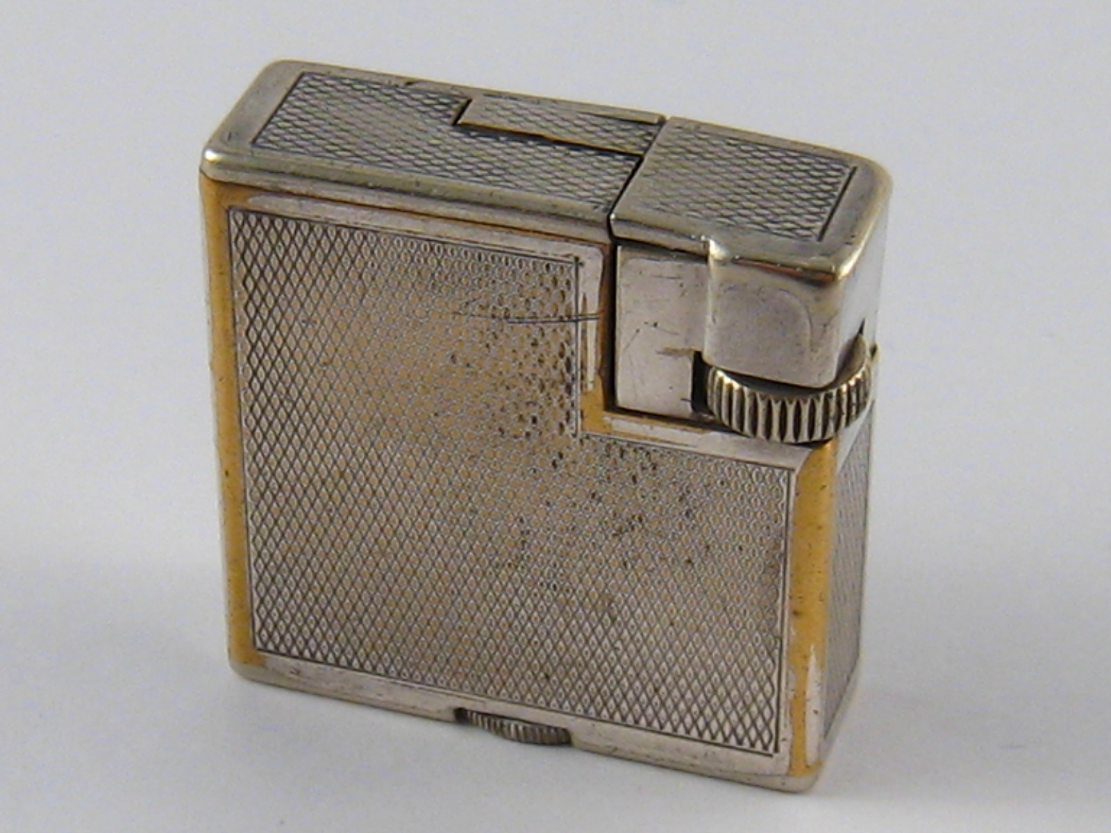 Lot 411 - A silver plate Dunhill London cigarette lighter, made in Switzerland, approx 3.5 x 3.5cm.