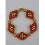A yellow metal (tests 18 carat gold) coral bracelet, approx 19cm long, 2cm wide, 20.7 gms.