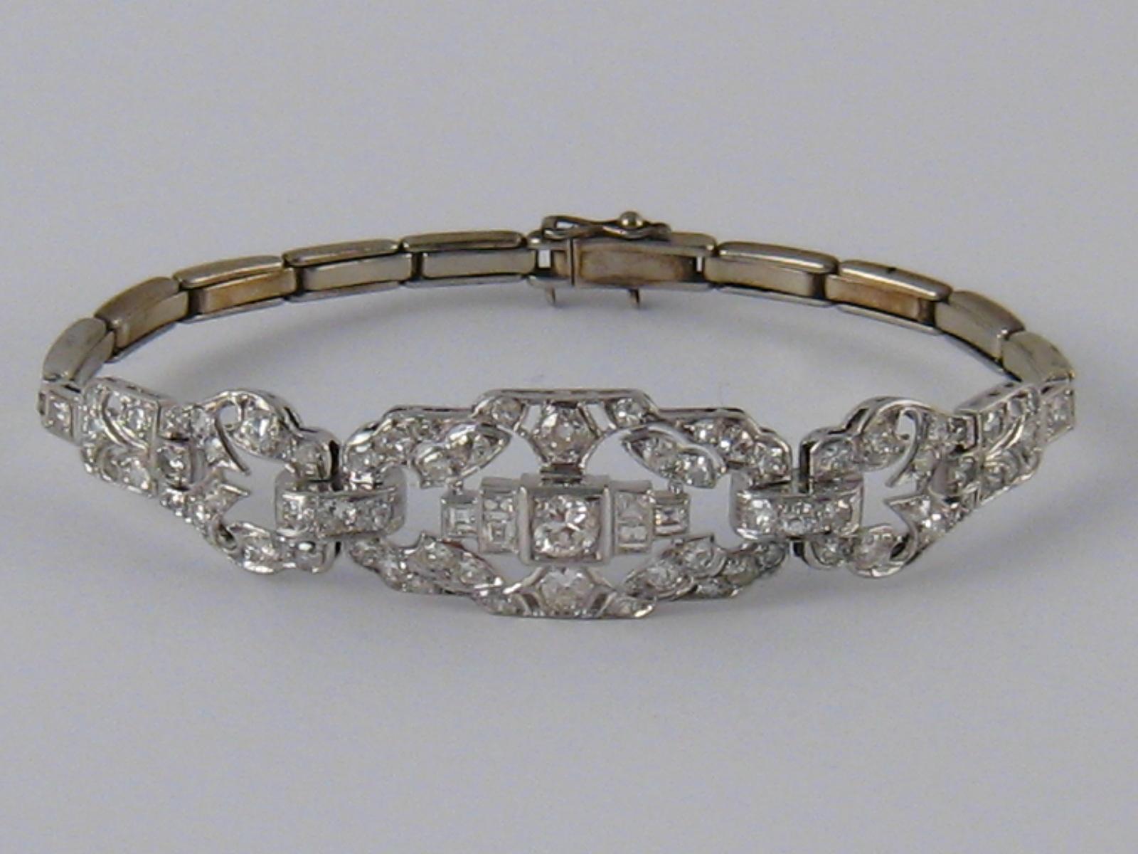 A white metal (tests 18 carat gold and platinum) diamond bracelet, numbered 648,