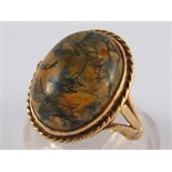 A 9 carat gold moss agate ring, agate approx 16 x 12.5mm, ring size J, 4.2 gms.