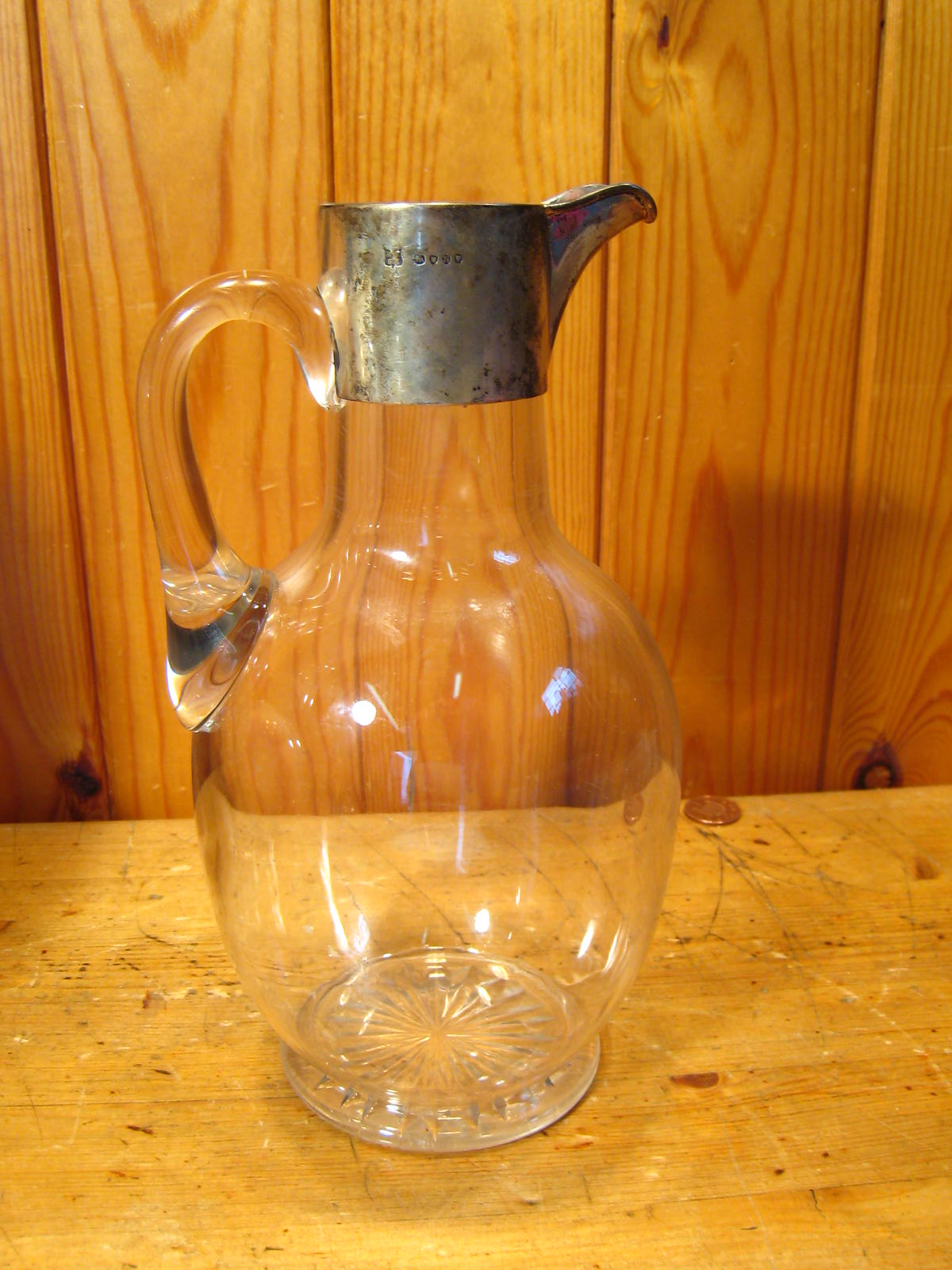 Lot 212 - A Victorian silver mounted glass water jug with star cut base, Rupert Favell & Co., London, 1888.