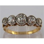 An 18 carat gold five stone old brilliant cut diamond ring, the largest stone measuring approx 4.
