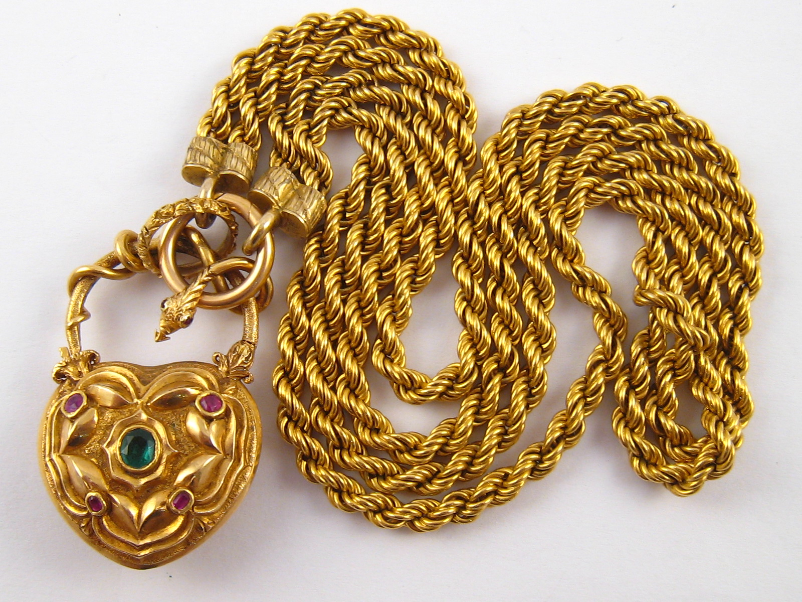 A fine antique gold necklace, the pendant symbolising love, designed as a heart shaped padlock