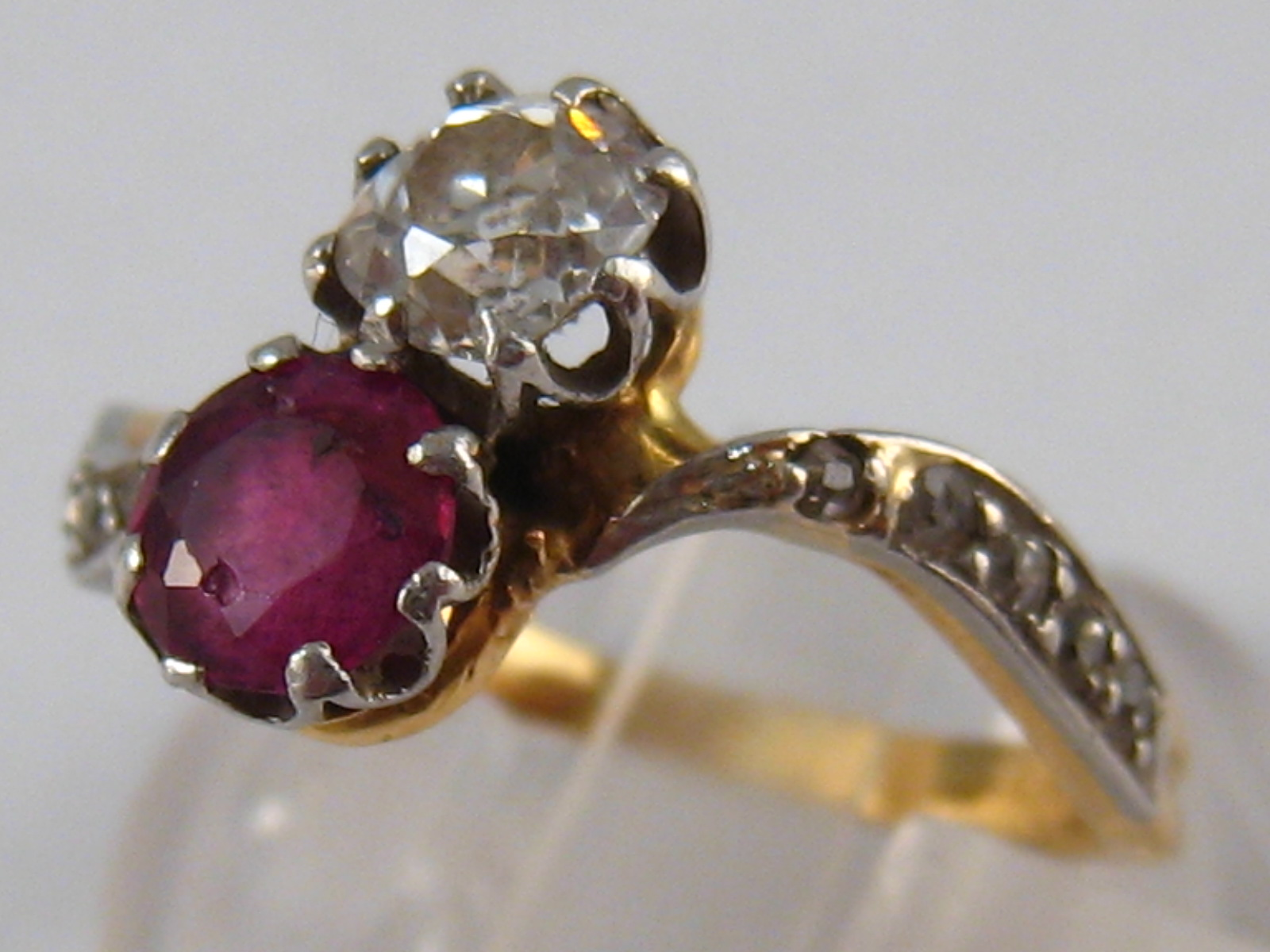 A yellow metal (tests 18 carat gold) diamond and ruby ring,