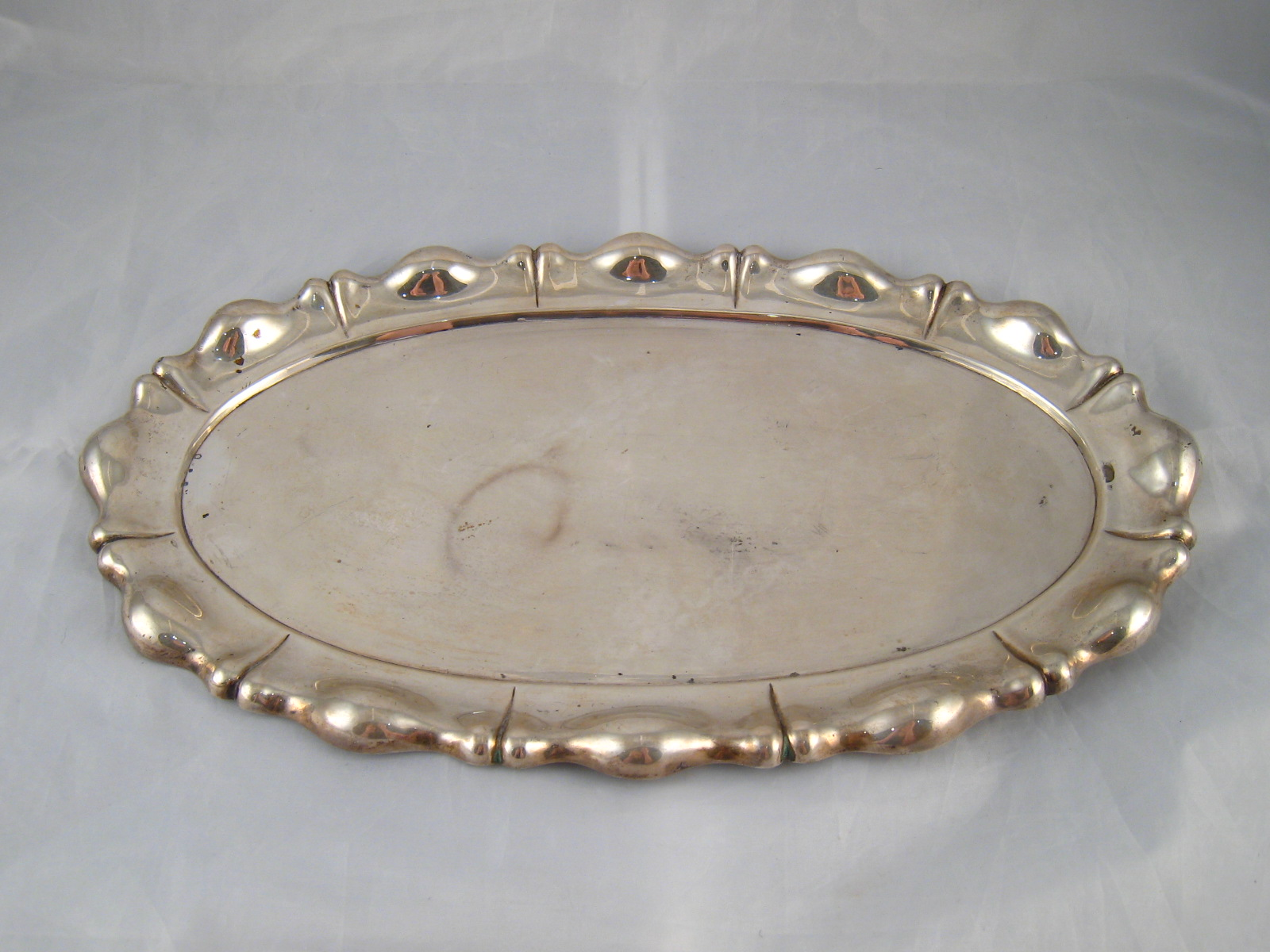 Lot 223 - An Austro Hungarian silver, 800 grade, oval dish with shaped rim . 23x37cm. wt. 512gm.