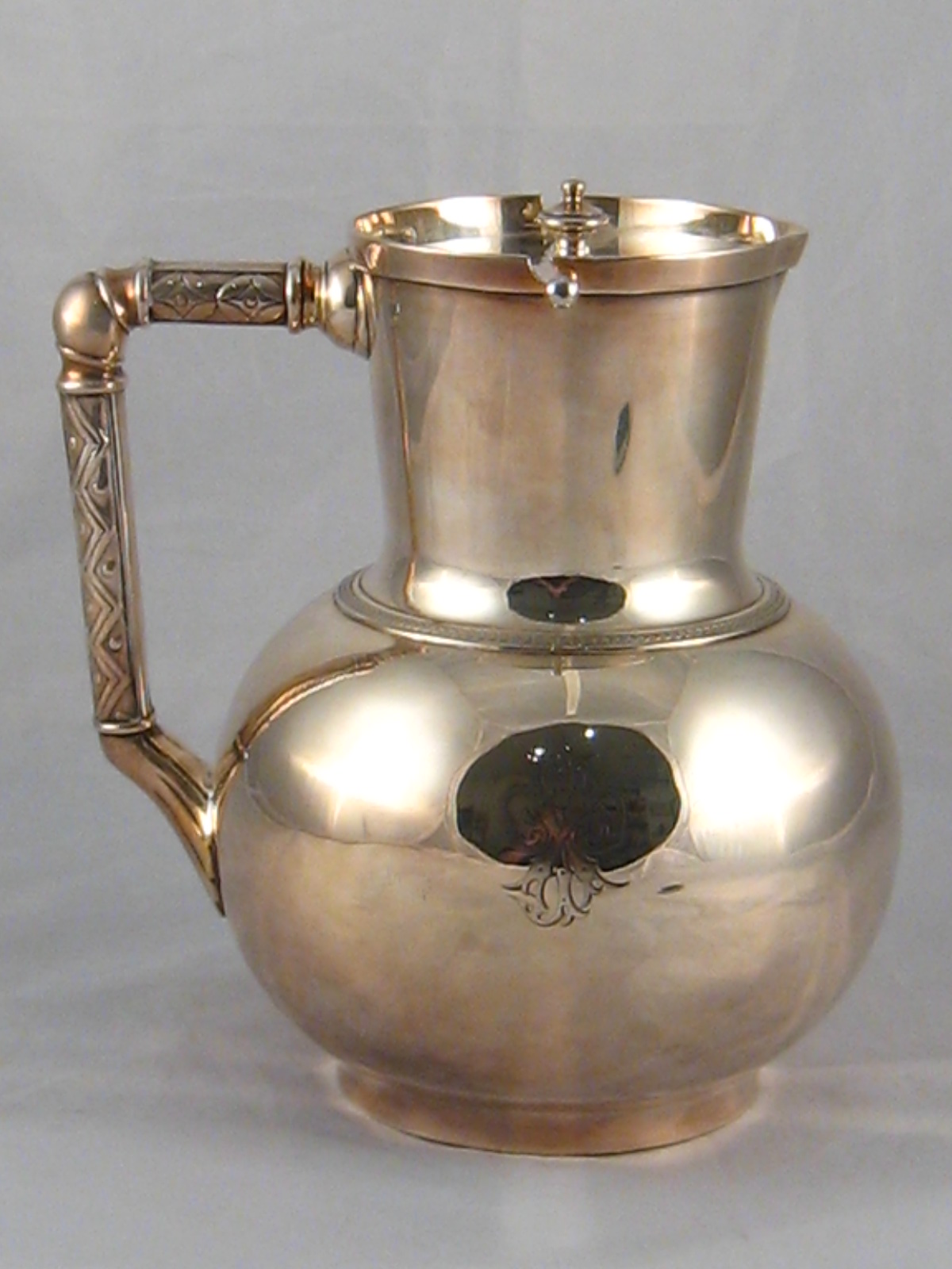 Lot 227 - A Victorian Elkington plate jug with automatic opening lid. Ht.19cm.