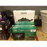 2 small green boxes of lED string lights and Christmas tree stand