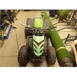 Green petrol powered quad bike