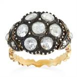 AN ANTIQUE DIAMOND CLUSTER RING, 19TH CENTURY set with seven rose cut diamonds accented by smaller