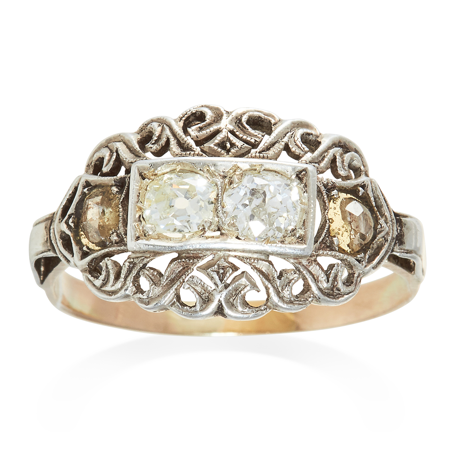 Los 304 - AN ANTIQUE DIAMOND RING in platinum or white gold, set with four diamonds among scrolling motifs,