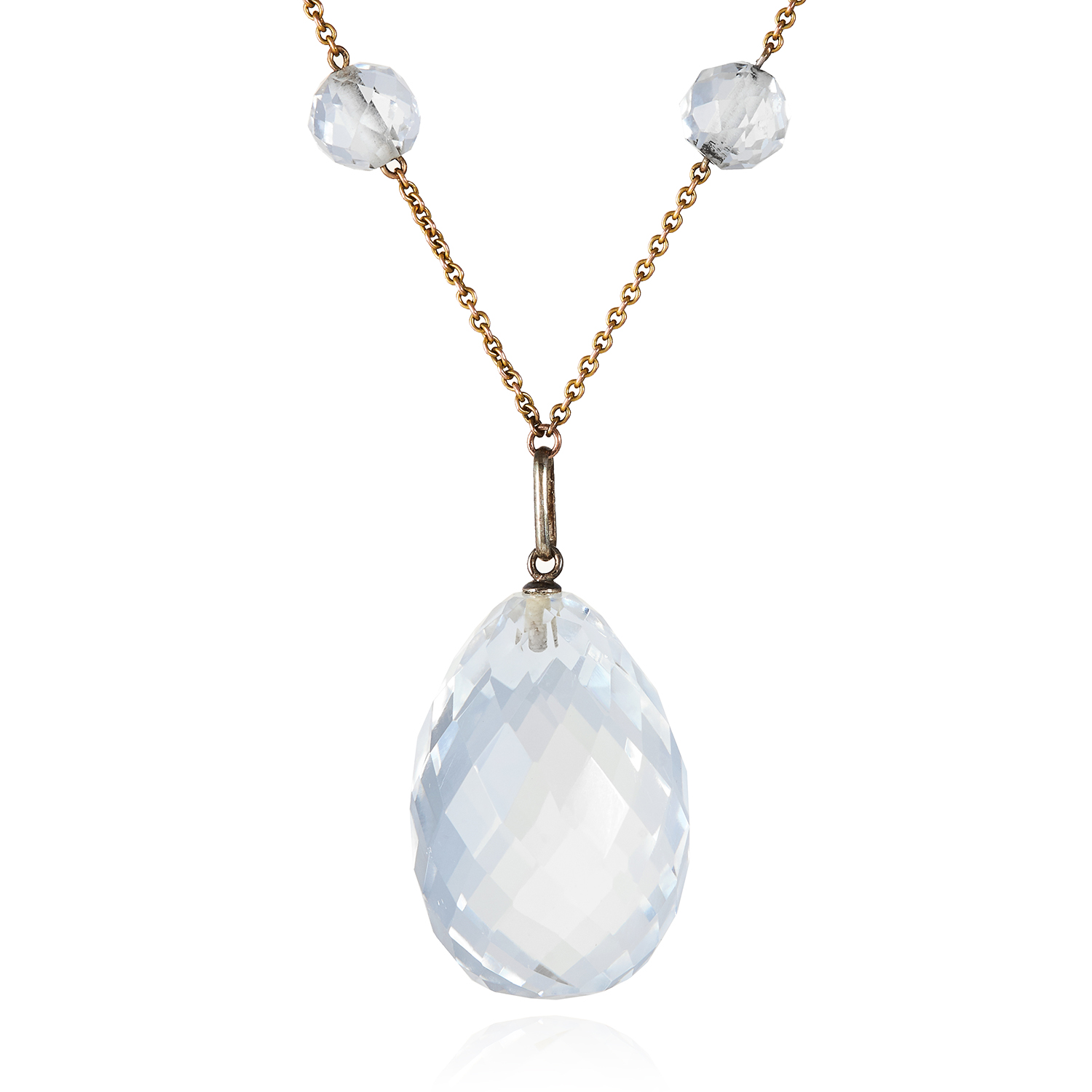 Los 518 - A ROCK CRYSTAL NECKLACE comprising of six faceted rock crystal beads suspending a large faceted rock