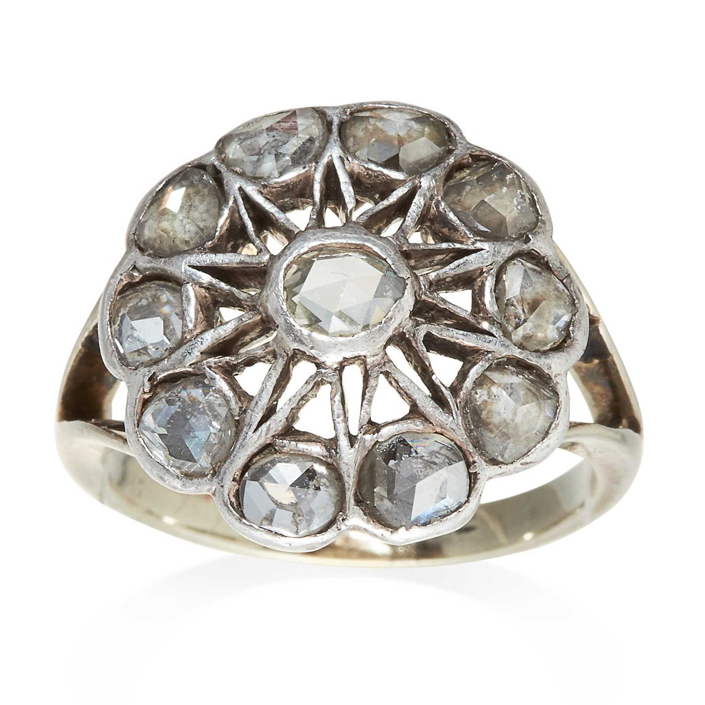 Los 338 - AN ANTIQUE DIAMOND DRESS RING in white gold or platinum, ten rose cut diamonds set in an openwork