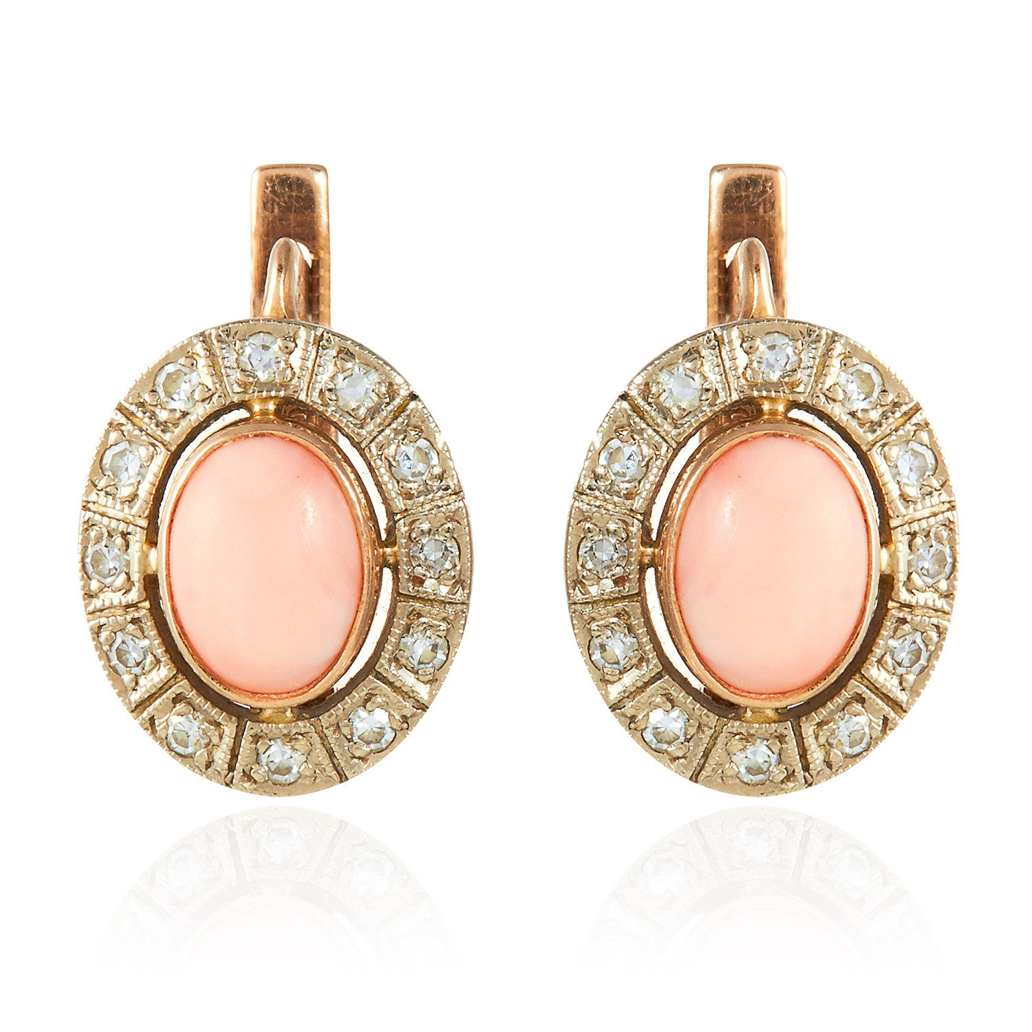 Los 348 - A PAIR OF CORAL AND DIAMOND EARRINGS in yellow gold, each oval cluster with coral at the centre,