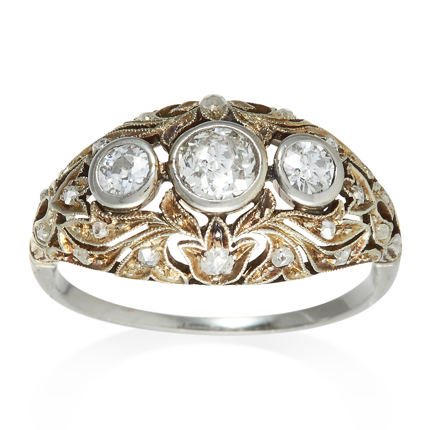 Los 352 - AN ART DECO DIAMOND RING in platinum or white gold, the trio of round cut diamonds, within scrolling