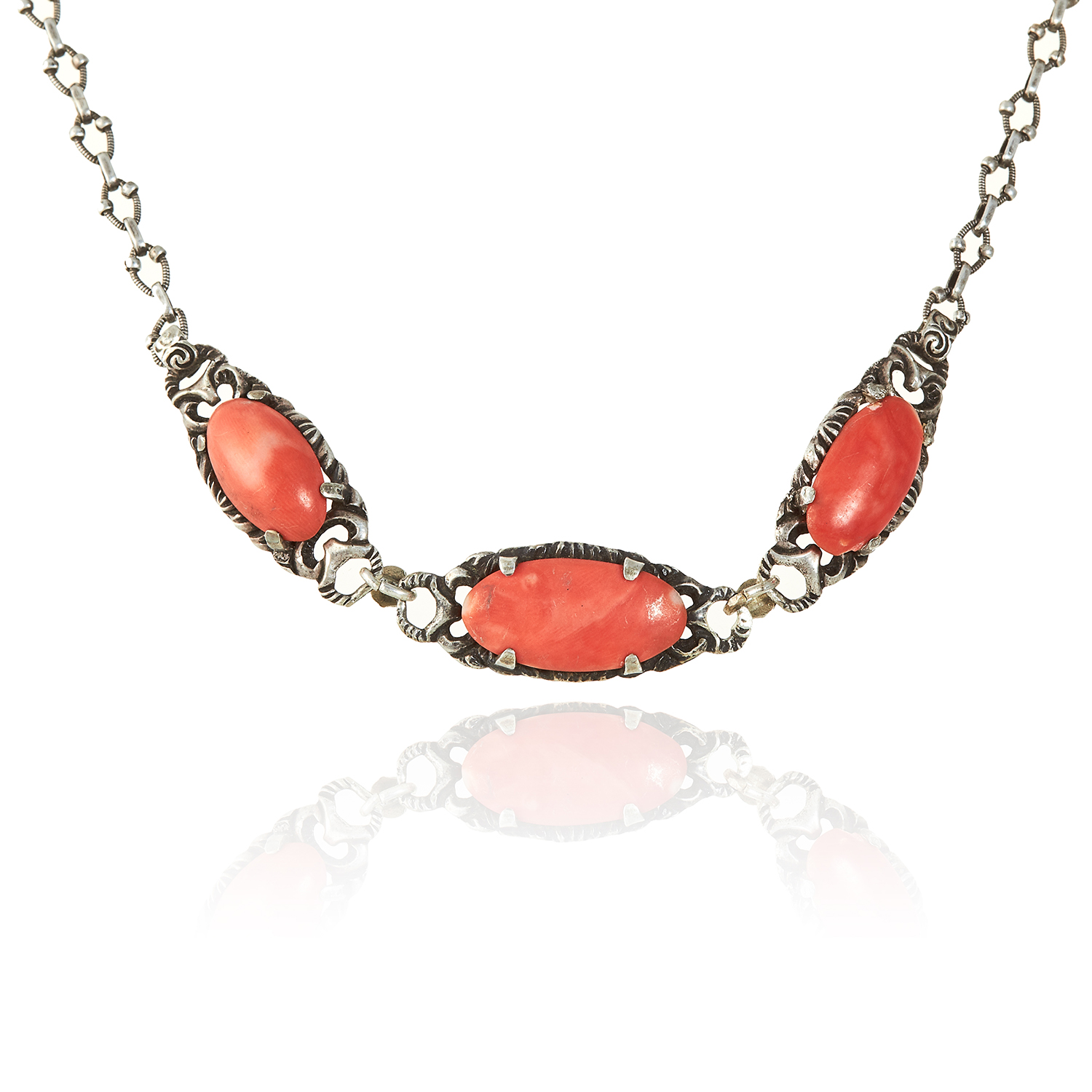 Los 344 - A CORAL NECKLACE in sterling silver, the three coral cabochons within foliate surrounds, unmarked,