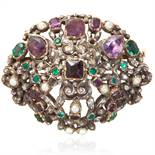 A JEWELLED ANTIQUE BROOCH, EARLY 19TH CENTURY in silver, the scrolling design jewelled with