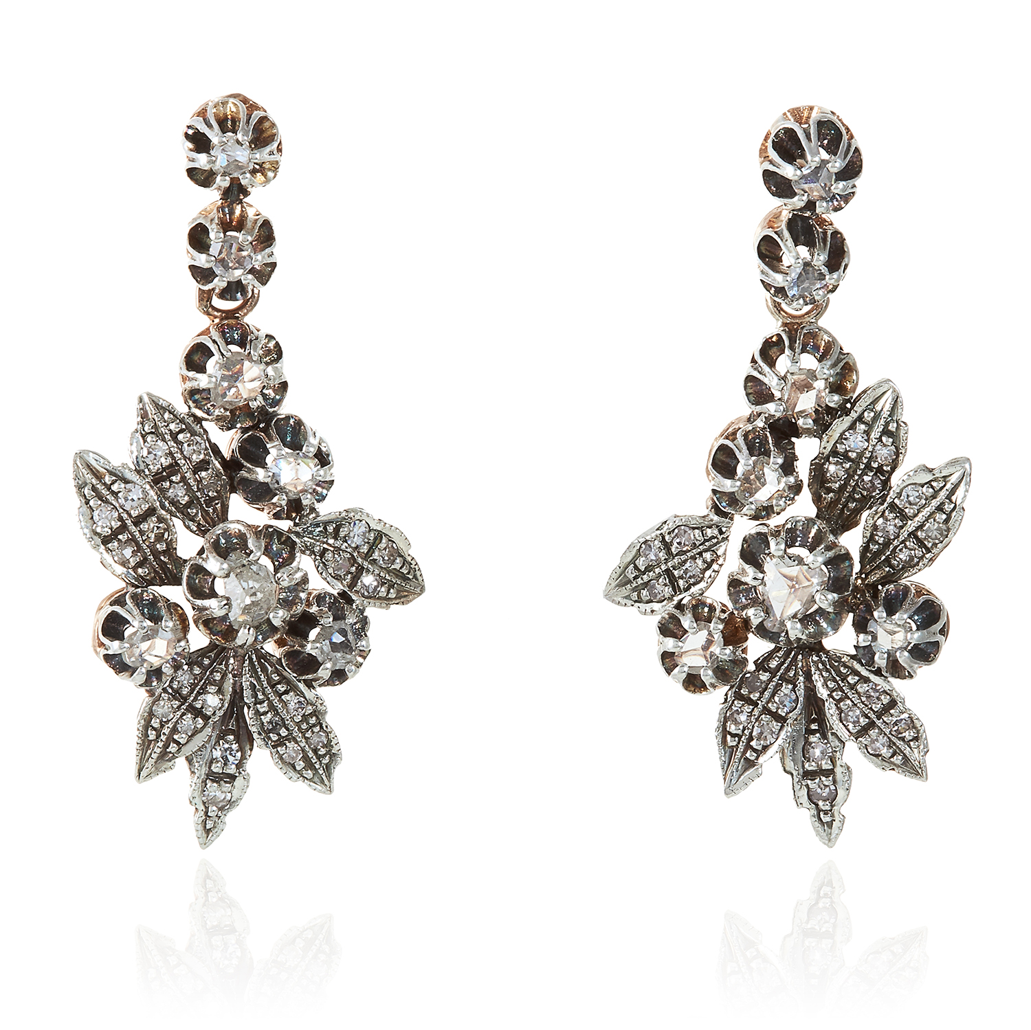 Los 355 - A PAIR OF ANTIQUE DIAMOND EARRINGS in high carat yellow gold and silver, designed as floral