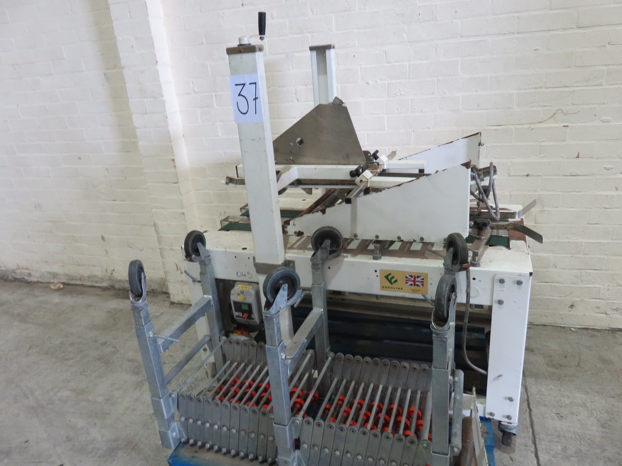 Lot 37 - Case Taper by Endoline. Top & bottom. Complete with retracing roller conveyor LIFT OUT £10