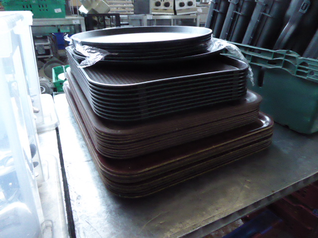 Lot 24 - Stack of assorted serving trays
