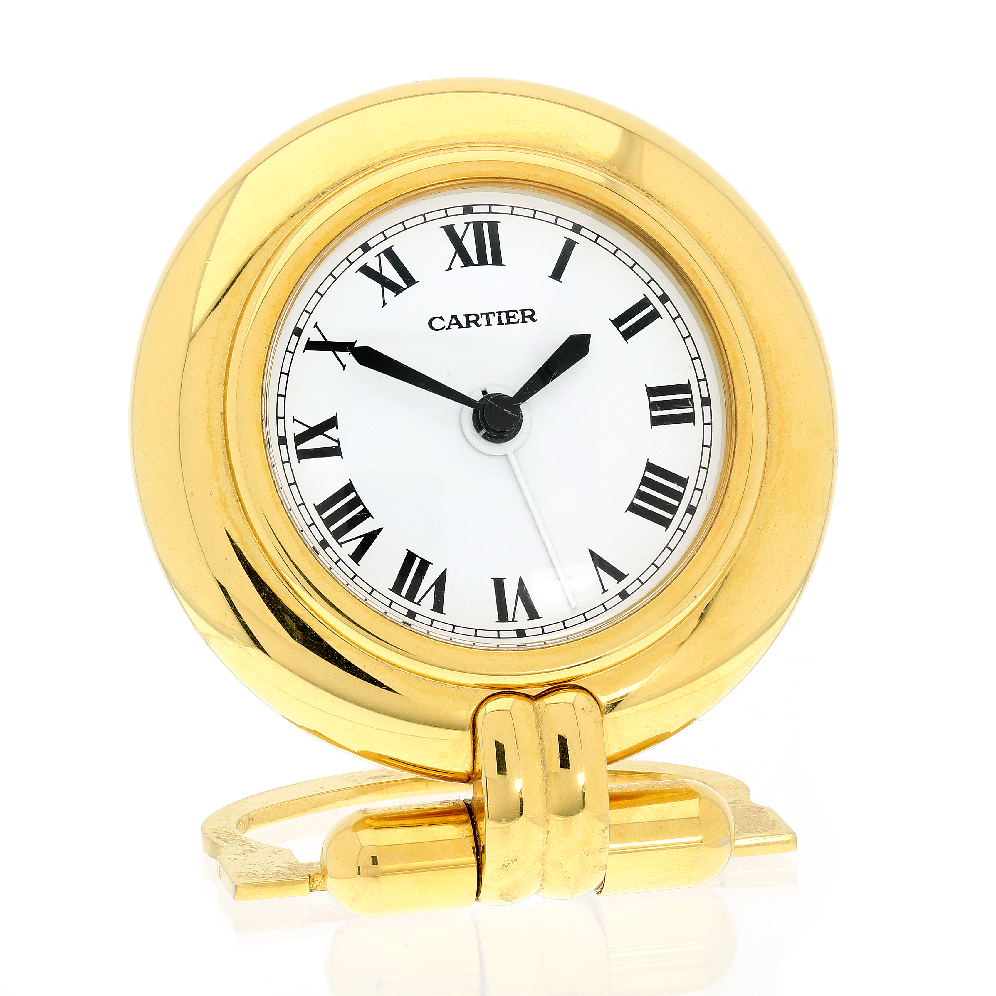 A VINTAGE TRAVEL / DESK CLOCK, CARTIER CIRCA 1980 24 carat gold plated, of circular form with a