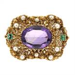 AN ANTIQUE AMETHYST, EMERALD AND PEARL BROOCH in high carat yellow gold, set with a large oval cut