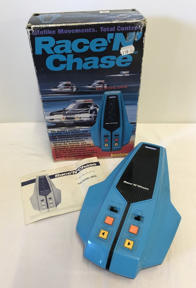 Lot 33 - Race 'N' Chase handheld electronic game by Bambino.