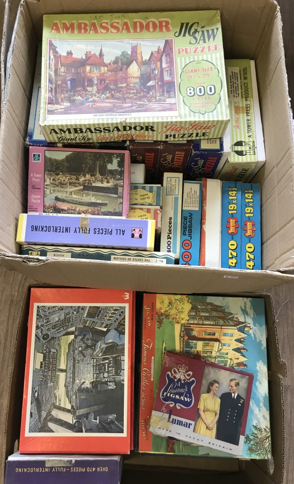 Lot 59 - 2 boxes of vintage jigsaw puzzles.
