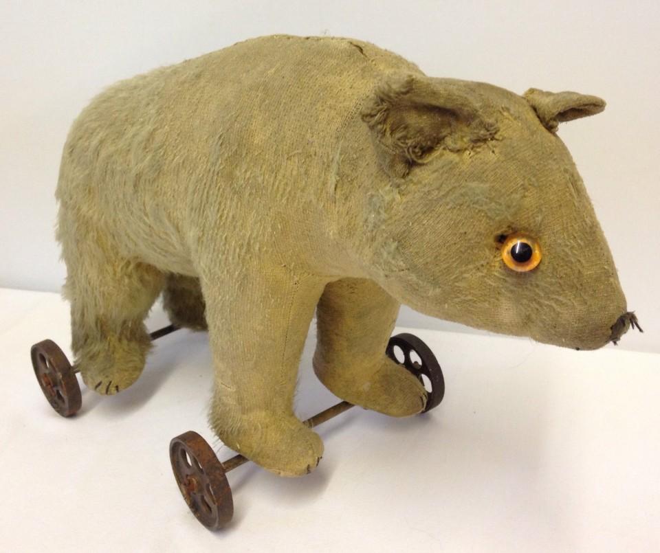 Lot 83 - Antique/vintage mohair pull-along teddy bear on wheels.