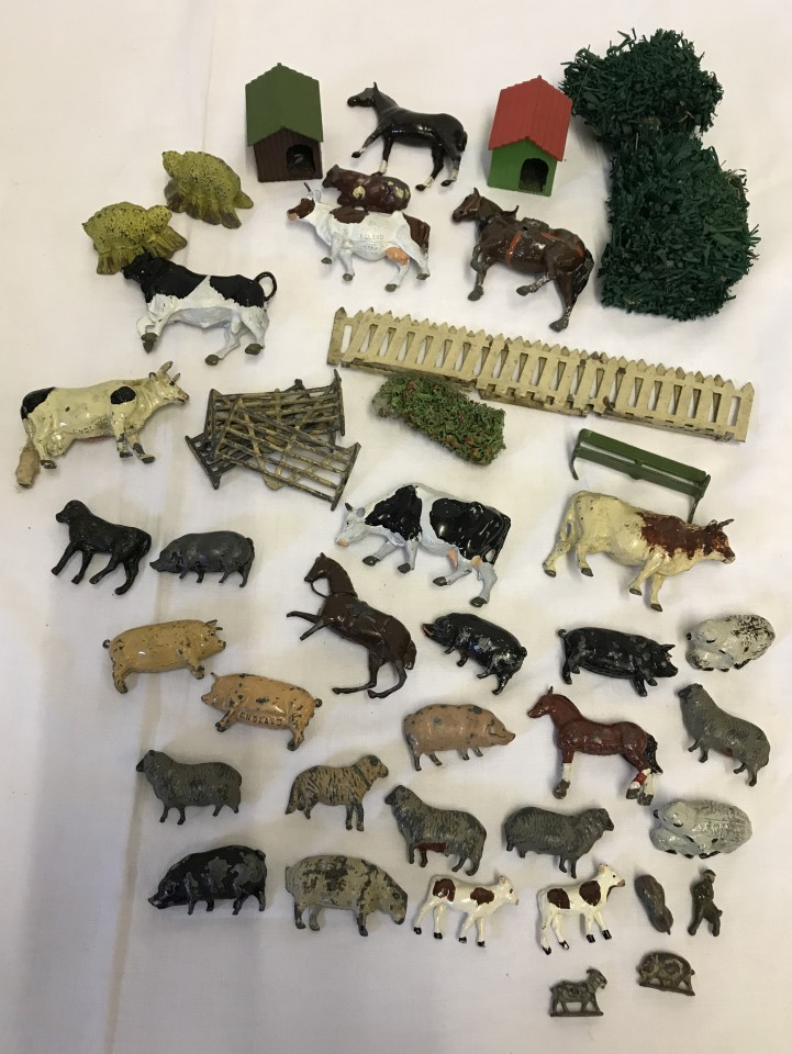 Lot 6 - A box of vintage lead farm animals and accessories.
