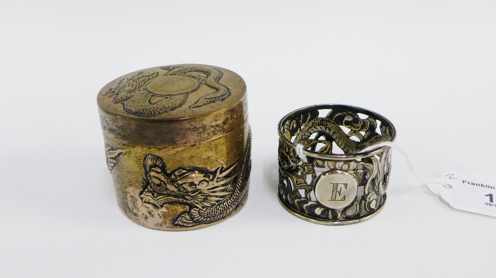 Lot 19 - Chinese white metal trinket box and cover, 5cm high, and a white metal napkin ring (2)