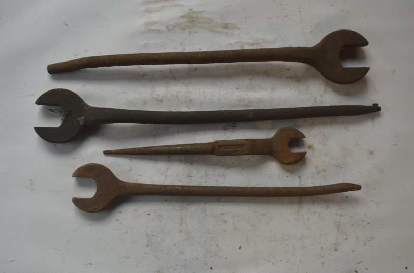 "Lot 22 - Four Podger spanners, length of longest approx. 19"" (4)."