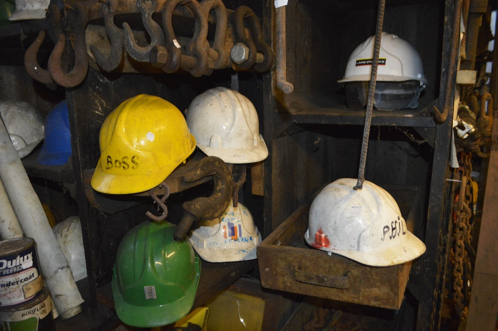 Lot 212 - A Stihl safety helmet and further helmets (strictly for decorative purposes only).
