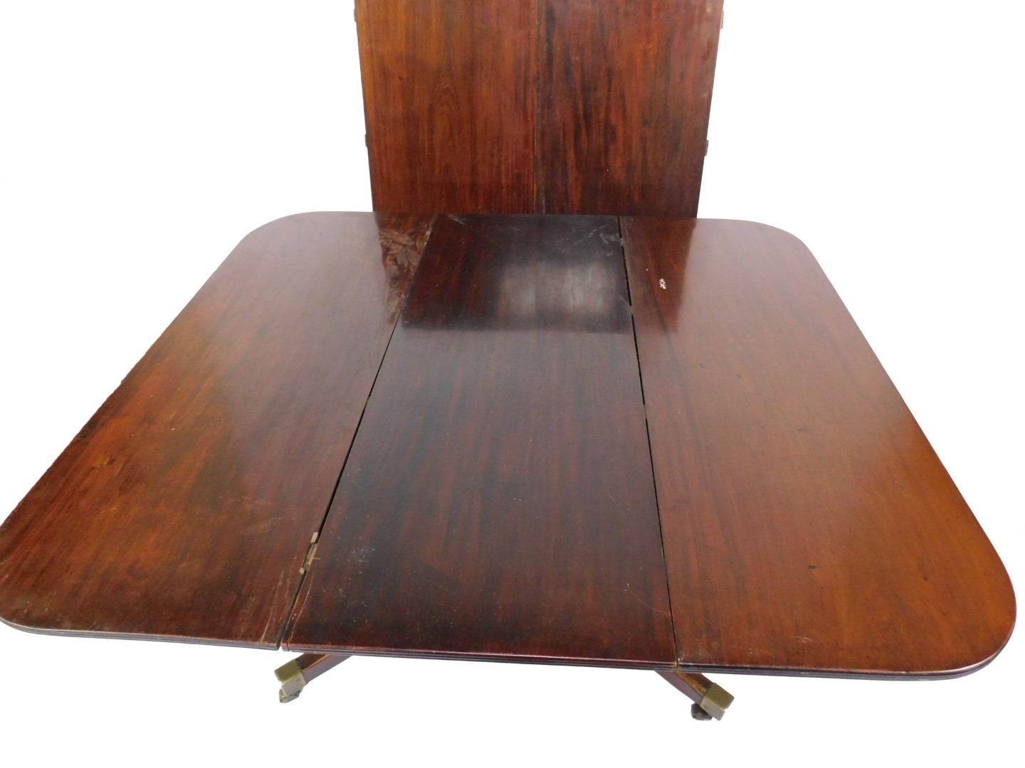 Lot 7 - A George III Pocock patent mahogany pull out extending pedestal dining table, the rounded and reeded