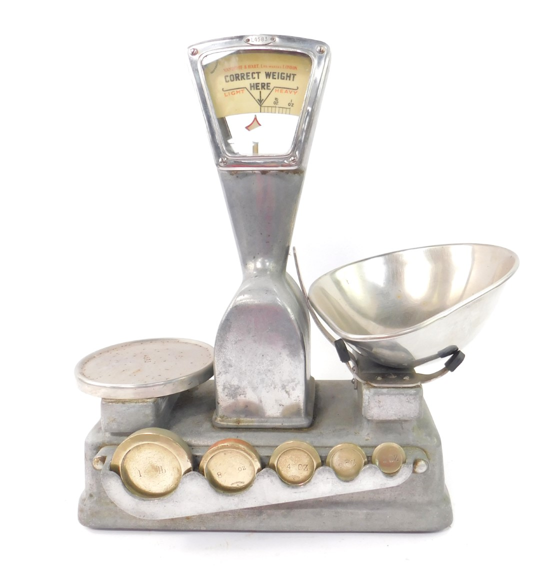 Lot 55 - A set of early 20thC Vandome & Hart grocery scales, no.4583, the base with recesses for graduated