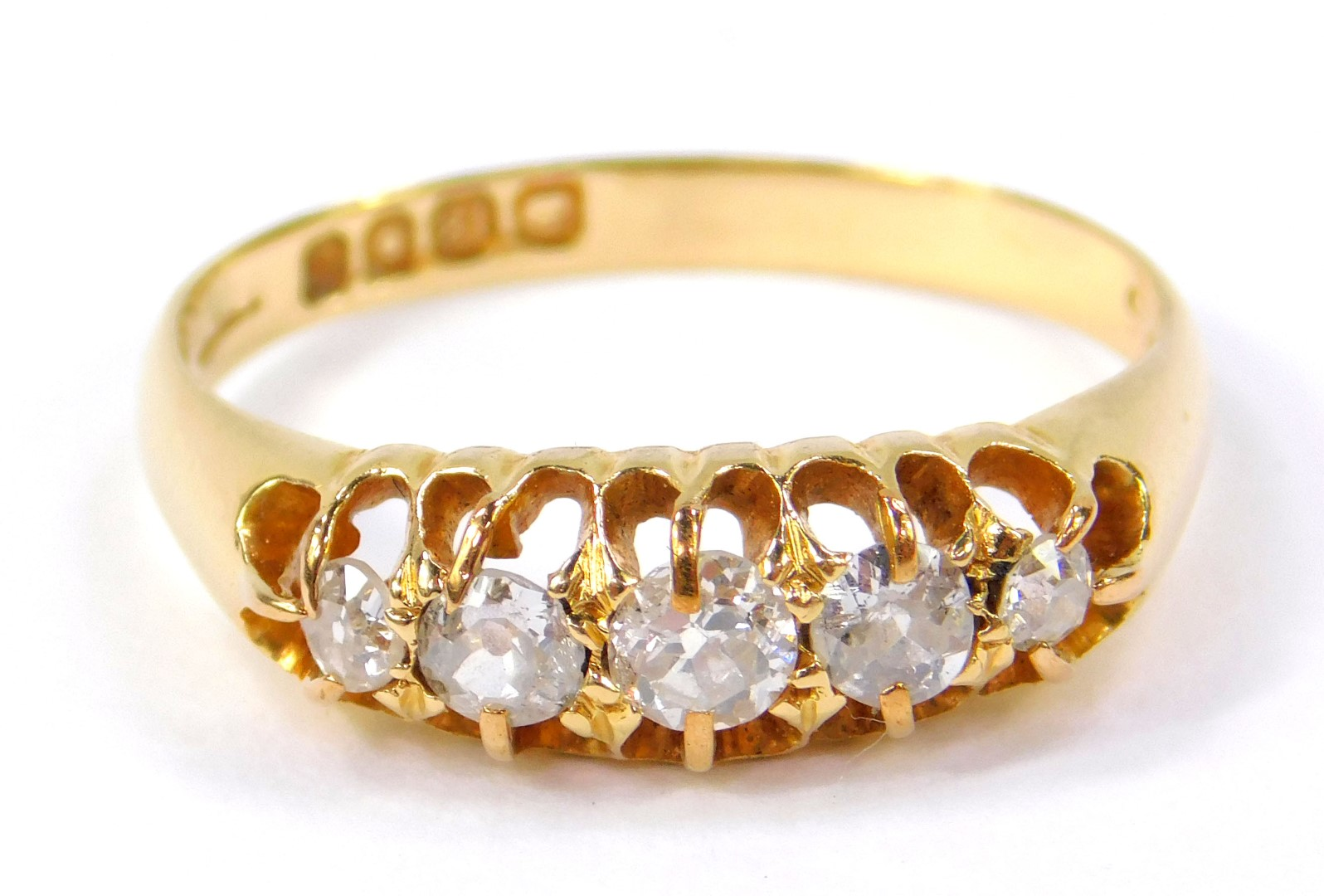 Lot 29 - An Edwardian 18ct gold and diamond five stone ring, in a graduated claw setting, approx 1/2ct,