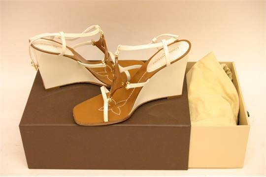 7b6ec2e480f0 A pair of ladies Louis Vuitton Capricieuse patent wedge sandals in ...