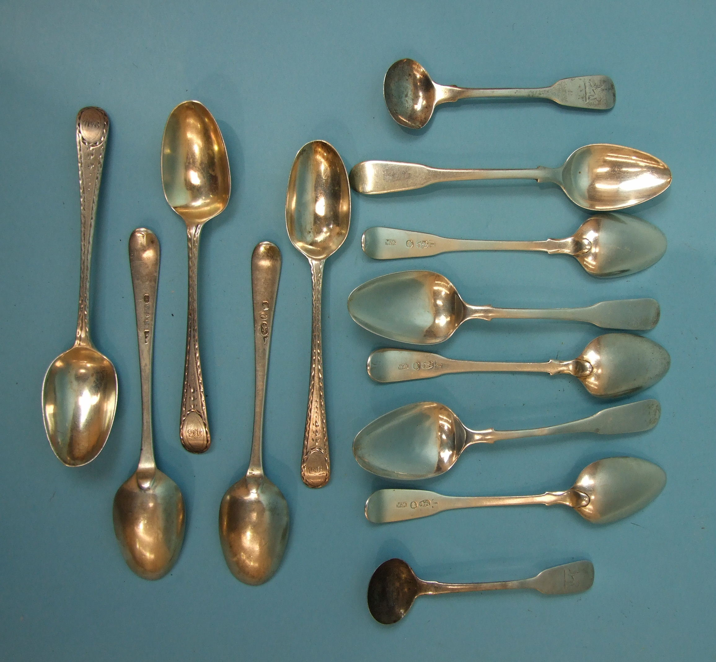 Lot 332 - A set of Georgian teaspoons, maker WW, five 18th century bright-cut teaspoons, London 1784 and a