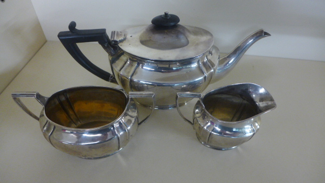 Lot 686 - A Silver Hallmarked three piece Tea Service, Edinburgh 1913-14 - consisting of a teapot,