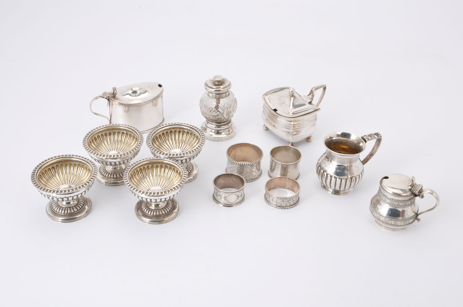 A collection of small silver mainly cruet items