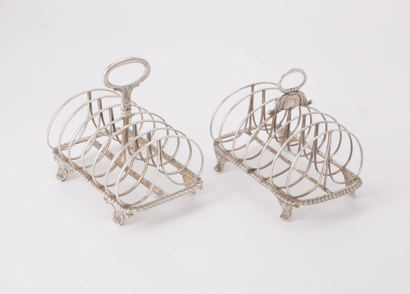Two similar silver six division toast racks