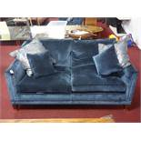 A Duresta 'Collingwood' sofa with blue velvet upholstery, raised on tapered legs