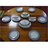 An early 20th century Royal Doulton dinner service, comprising 1 large tureen, 1 smaller tureen, 2
