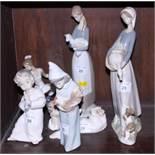 Six Lladro porcelain figures including a ballet dancer and two cherubs